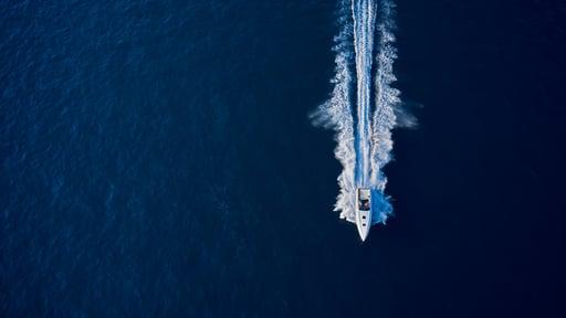 A boat speeding over the open ocean.